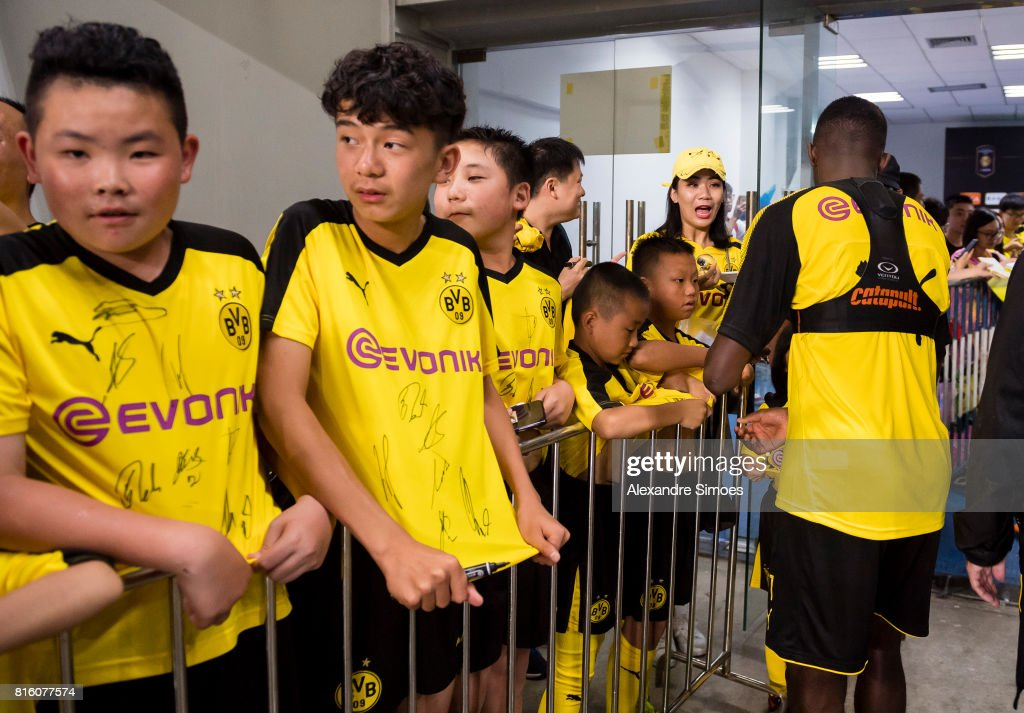 Ousmane Dembele of Borussia Dortmund together with some young chinese fans after a training session during the Borussia Dortmund Asian Summer Tour on July 17, 2017 in Guangzhou, China.