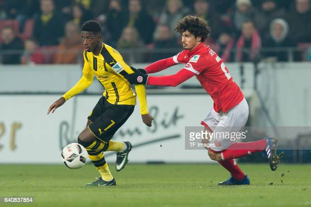 Ousmane Dembele of Dortmund and Andre Ramalho of Mainz battle for the ball during the Bundesliga match between 1 FSV Mainz 05 and Borussia Dortmund...