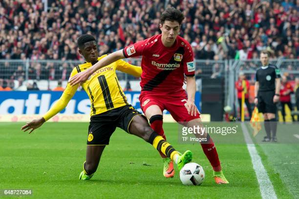 Ousmane Dembele of Dortmund and Kai Havertz of Bayer Leverkusen battle for the ball during the Bundesliga match between Borussia Dortmund and Bayer...