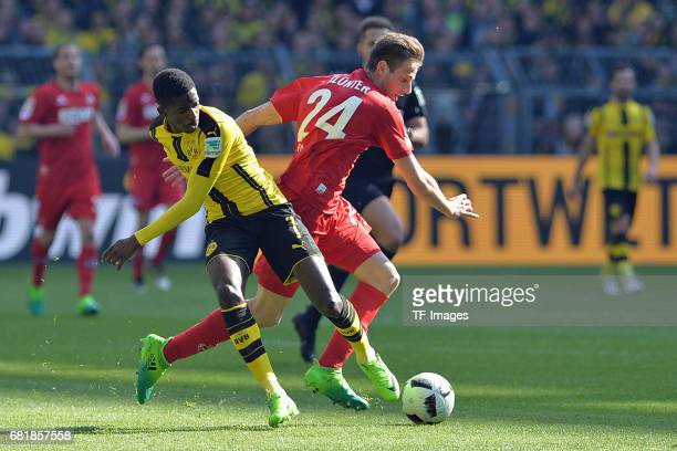 Ousmane Dembele of Dortmund and Lukas Kluenter of Colonge battle for the ball during the Bundesliga match between Borussia Dortmund and FC Koeln at...