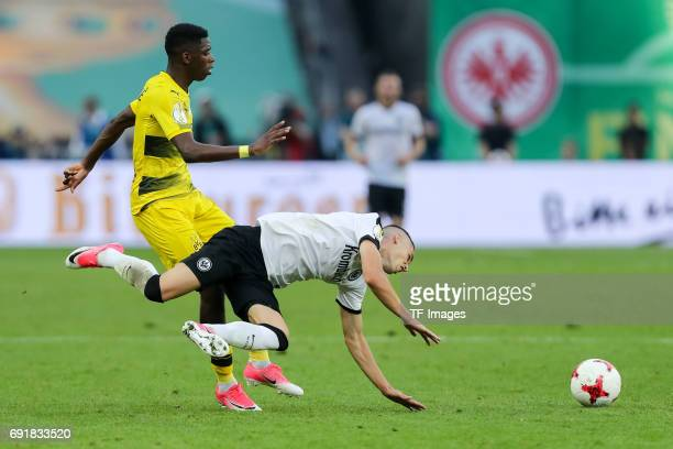 Ousmane Dembele of Dortmund and Mijat Gacinovic of Frankfurt battle for the ball during the DFB Cup final match between Eintracht Frankfurt and...