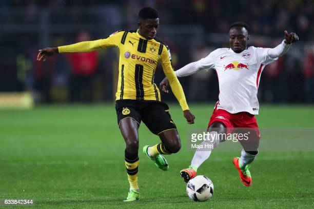 Ousmane Dembele of Dortmund and Naby Keita of Leipzig battle for the ball during the Bundesliga match between Borussia Dortmund and RB Leipzig at...