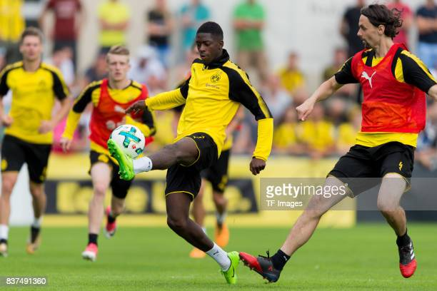 Ousmane Dembele of Dortmund and Neven Subotic of Dortmund battle for the ball during a training session as part of the training camp on July 31 2017...