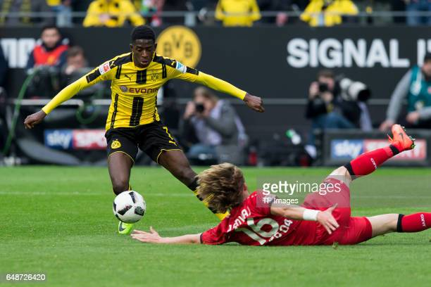 Ousmane Dembele of Dortmund and Tin Jedvaj of Bayer Leverkusen battle for the ball during the Bundesliga match between Borussia Dortmund and Bayer 04...