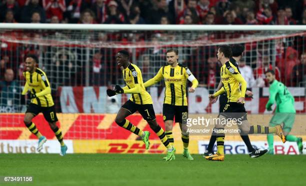 Ousmane Dembele of Dortmund celebrates after he scores the 3rd goal during the DFB Cup semi final match between FC Bayern Muenchen and Borussia...