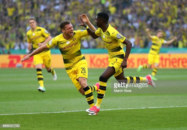 Ousmane Dembele of Dortmund celebrates after scoring his team's first goal with his team mates during the DFB Cup Final 2017 between Eintracht...