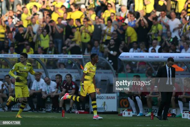 Ousmane Dembele of Dortmund celebrates his opening goal next to head coach Nico Kovac of Eintracht Frankfurt during the DFB Cup final match between...