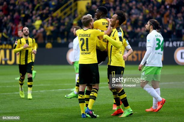 Ousmane Dembele of Dortmund celebrates the third goal with Andre Schuerrle and PierreEmerick Aubameyang of Dortmund during the Bundesliga match...