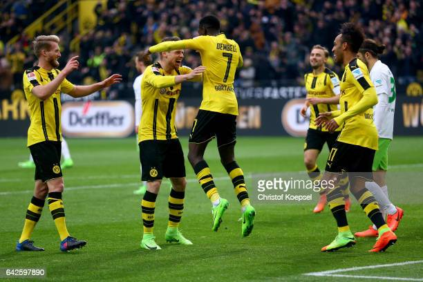 Ousmane Dembele of Dortmund celebrates the third goal with Lukasz Piszczek of Dortmund during the Bundesliga match between Borussia Dortmund and VfL...