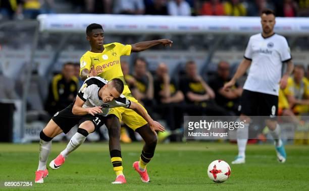 Ousmane Dembele of Dortmund challenges Mijat Gacinovic of Frankfurt during the DFB Cup Final 2017 between Eintracht Frankfurt and Borussia Dortmund...