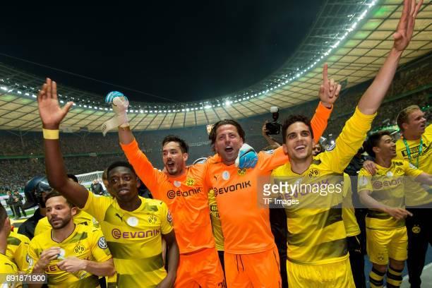 Ousmane Dembele of Dortmund Goalkeeper Roman Buerki of Dortmund Goalkeeper Roman Weidenfeller of Dortmund and Marc Bartra of Dortmund celebrates...