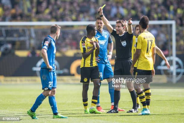 Ousmane Dembele of Dortmund is snown a yellow card by referee during the Bundesliga match between Borussia Dortmund and TSG 1899 Hoffenheim at Signal...