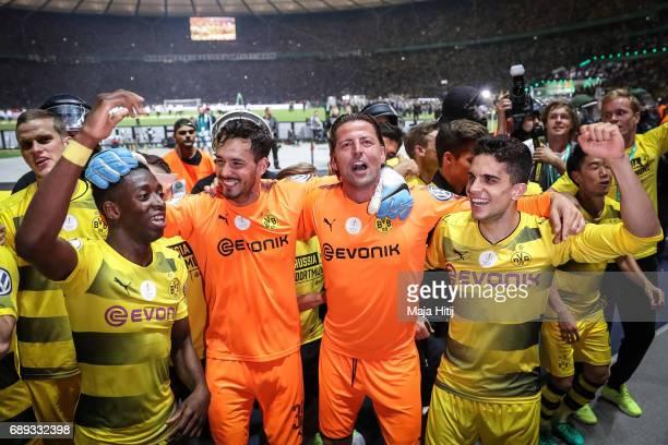 Ousmane Dembele of Dortmund Roman Buerki Roman Weidenfeller and Marc Bartra celebrate after winning the DFB Cup final match between Eintracht...