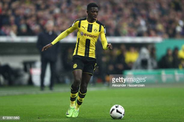 Ousmane Dembele of Dortmund runs with the ball during the DFB Cup semi final match between FC Bayern Muenchen and Borussia Dortmund at Allianz Arena...