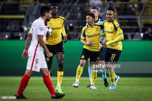 Ousmane Dembele of Dortmund Shinji Kagawa and PierreEmerick Aubameyang celebrate after scoring a goal to make it 12 during the UEFA Champions League...