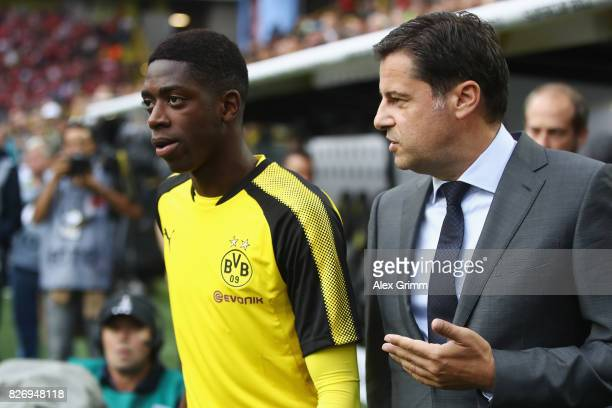Ousmane Dembele of Dortmund walks with DFL CEO Christian Seifert before receiving his 'Rookie 2017' award prior to the DFL Supercup 2017 match...