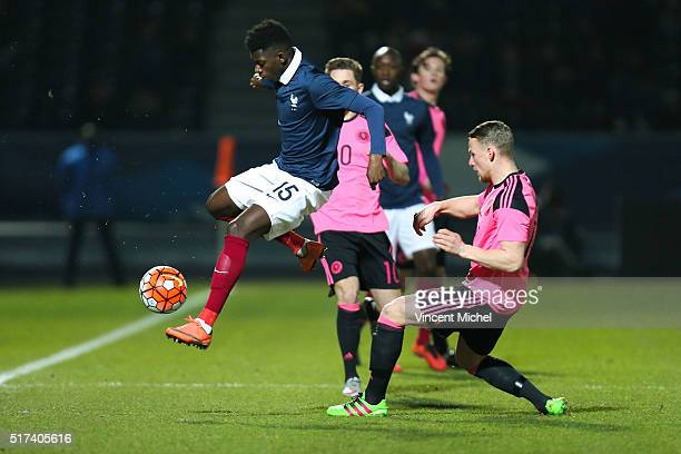 Ousmane Dembele of France and Stephen Hendrie of Scotland during the Uefa U21 European Championship qualifier between France and Scotland at Stade...