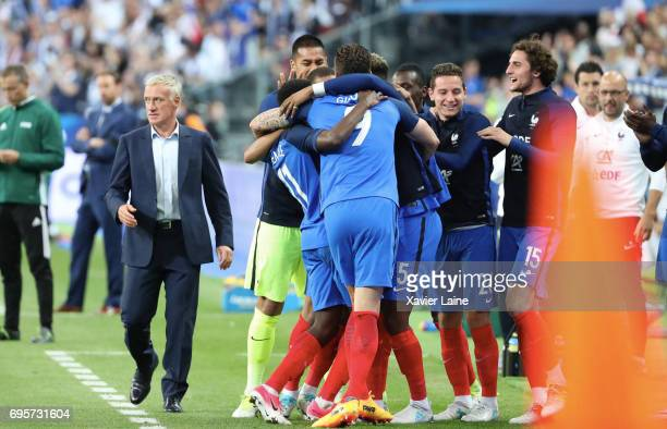 Ousmane Dembele of France celebrate his goal with Didier Deschamps and teammattes during the International Friendly match between France and England...