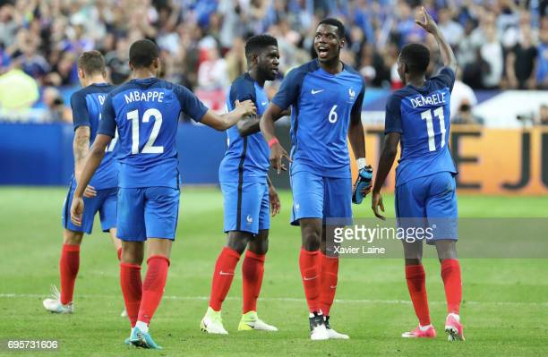 Ousmane Dembele of France celebrate his goal with Kylian Mbappe and Paul Pogba during the International Friendly match between France and England at...