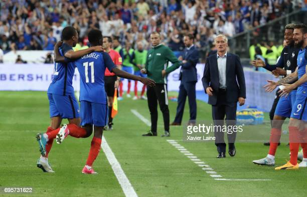 Ousmane Dembele of France celebrate his goal with Kylian Mbappe during the International Friendly match between France and England at Stade de France...