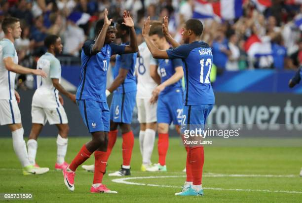 Ousmane Dembele of France celebrate the victory with Kylian Mbappe during the International Friendly match between France and England at Stade de...