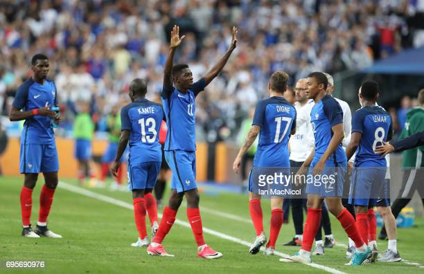 Ousmane Dembele of France celebrates after he scores his team's third goal during the international Friendly match between France and England at...
