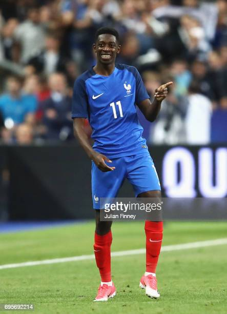 Ousmane Dembele of France celebrates as he scores their third goal during the International Friendly match between France and England at Stade de...