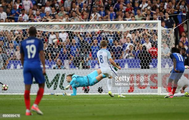 Ousmane Dembele of France scores a goal to make the score 32 during the International Friendly match between France and England at Stade de France on...
