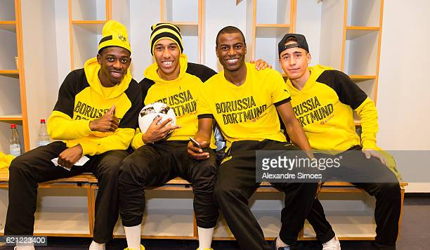 Ousmane Dembele PierreEmerick Aubameyang Adrian Ramos and Emre Mor posing after winning the math with the matchball in the dressing room after the...