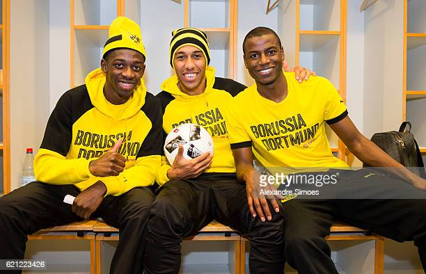 Ousmane Dembele PierreEmerick Aubameyang and Adrian Ramos posing after winning the math with the matchball in the dressing room after the Bundesliga...