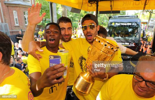 Ousmane Dembele Sokratis Papastathopoulos and PierreEmerick Aubameyang of Borussia Dortmund lift the DFB Cup trophy as the team celebrates during a...
