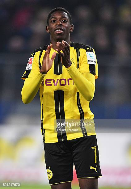 Ousmane Dembélé of Dortmund celebrates scoring the fifth goal during the Bundesliga match between Hamburger SV and Borussia Dortmund at...