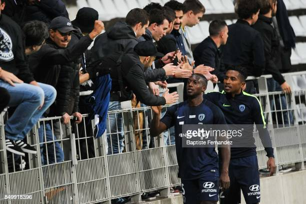 Ousmane Sidibe and Lalaine Henintsoa Nomenjanahary of Paris FC celebrate with fans during the French Ligue 2 mach between Paris FC and Orleans at...
