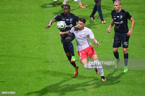 Ousmane Sidibe of Paris FC and Panagiotis Vlachodimos of Nimes during the Ligue 2 match between Paris FC and Nimes on September 29 2017 in Paris...