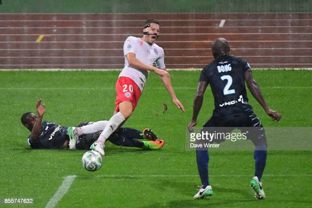 Ousmane Sidibe of Paris FC Renaud Ripart of Nimes and Frederic Bong of Paris FC during the Ligue 2 match between Paris FC and Nimes on September 29...