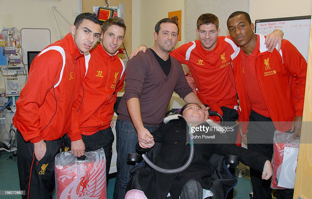 Oussama Assaidi, Joe Allen, Steven Gerrard and Andre Wisdom of Liverpool FC visit Alder Hey Children's Hospital on December 12, 2012 in Liverpool, England.