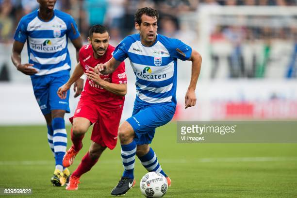 Oussama Assaidi of FC Twente Dirk Marcellis of PEC Zwolle during the Dutch Eredivisie match between PEC Zwolle and FC Twente at the MAC3Park stadium...