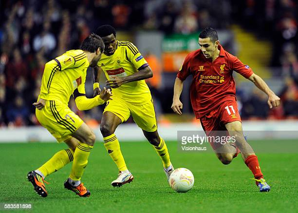 Oussama Assaidi of Liverpool takes on Kamil Agalarov and Samuel Eto'o of FC Anji Makhachkala during the UEFA Europa League Group A match between...