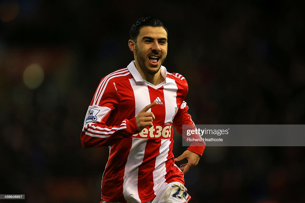 <a gi-track='captionPersonalityLinkClicked' href=/galleries/search?phrase=Oussama+Assaidi&family=editorial&specificpeople=5909753 ng-click='$event.stopPropagation()'>Oussama Assaidi</a> of Stoke City celebrates scoring the opening goal during the Barclays Premier League match between Stoke City and Everton at Britannia Stadium on January 1, 2014 in Stoke on Trent, England.