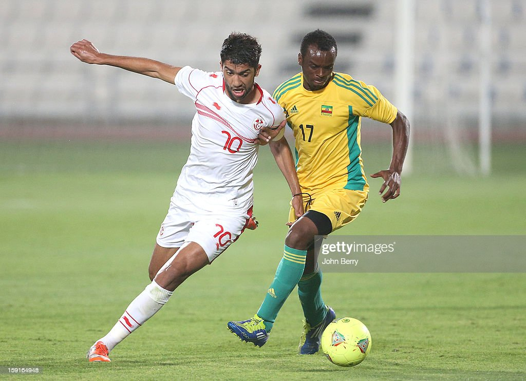 Oussama Darragi of Tunisia and Siyoum Tesfaye of Ethiopia in action during the international friendly game between Tunisia and Ethiopia at the Al Wakrah Stadium on January 7, 2013 in Doha, Qatar.