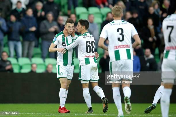 Oussama Idrissi of FC Groningen celebrates 22 with Ludovit Reis of FC Groningen during the Dutch Eredivisie match between FC Groningen v Vitesse at...