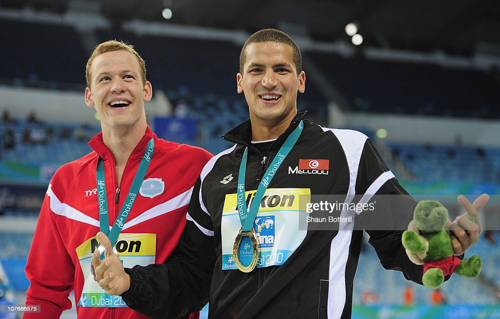 <a gi-track='captionPersonalityLinkClicked' href=/galleries/search?phrase=Oussama+Mellouli&family=editorial&specificpeople=2297983 ng-click='$event.stopPropagation()'>Oussama Mellouli</a> of Tunisia (Gold) and Mads Glaesner (Silver) of Denmark in the final of the Men's 1500m Freestyle during the 10th FINA World Swimming Championships (25m) at the Hamdan bin Mohammed bin Rashid Sports Complex on December 19, 2010 in Dubai, United Arab Emirates.