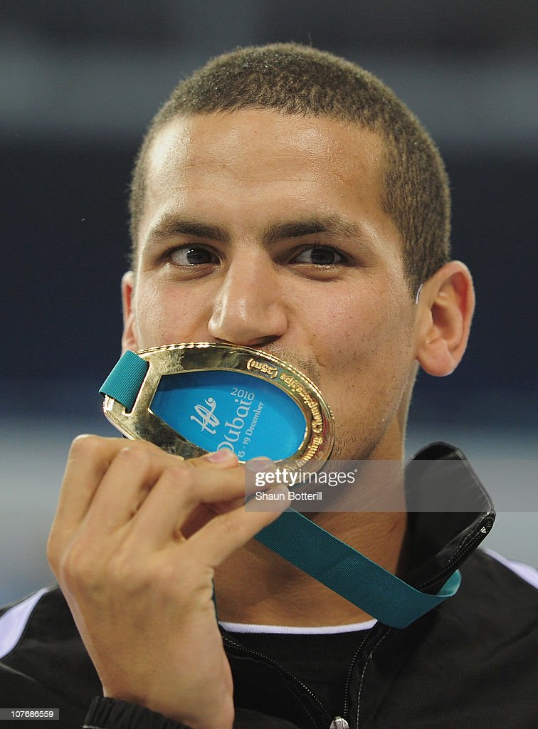 <a gi-track='captionPersonalityLinkClicked' href=/galleries/search?phrase=Oussama+Mellouli&family=editorial&specificpeople=2297983 ng-click='$event.stopPropagation()'>Oussama Mellouli</a> of Tunisia (Gold) in the final of the Men's 1500m Freestyle during the 10th FINA World Swimming Championships (25m) at the Hamdan bin Mohammed bin Rashid Sports Complex on December 19, 2010 in Dubai, United Arab Emirates.