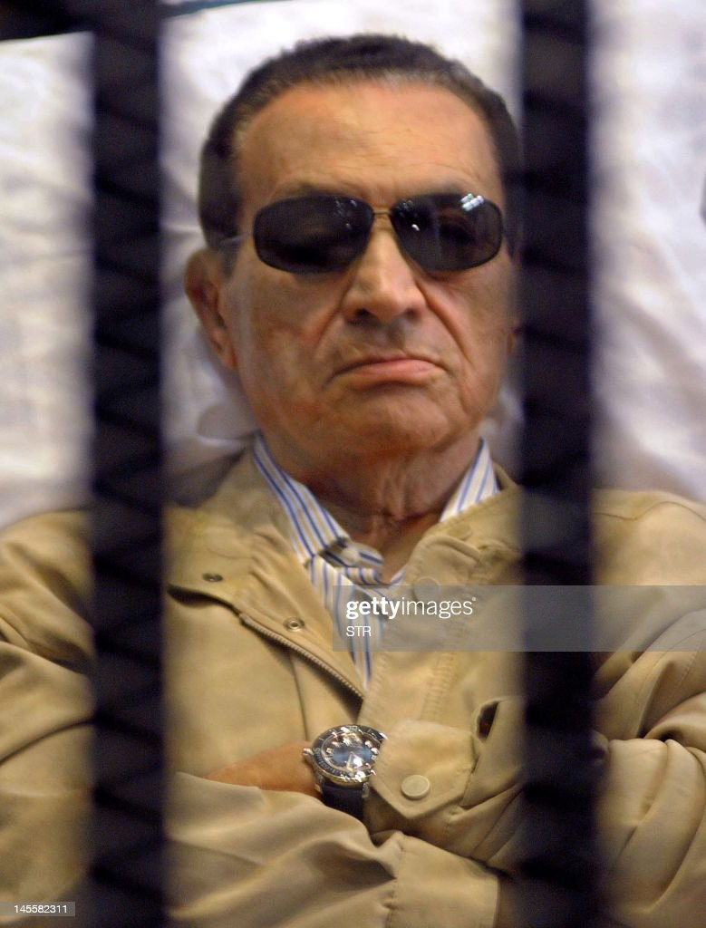 Ousted Egyptian president <a gi-track='captionPersonalityLinkClicked' href=/galleries/search?phrase=Hosni+Mubarak&family=editorial&specificpeople=201752 ng-click='$event.stopPropagation()'>Hosni Mubarak</a> sits inside a cage in a courtroom during his verdict hearing in Cairo on June 2, 2012. A judge sentenced Mubarak to life in prison after convicting him of involvement in the murder of protesters during the uprising that ousted him last year. AFP PHOTO/STR