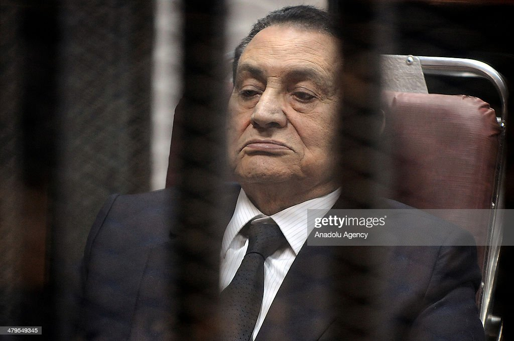 Ousted Egyptian president Hosni Mubarek, in suit, appears in the trial about expenses for presidential palaces on March 19, 2014 in Cairo, Egypt.