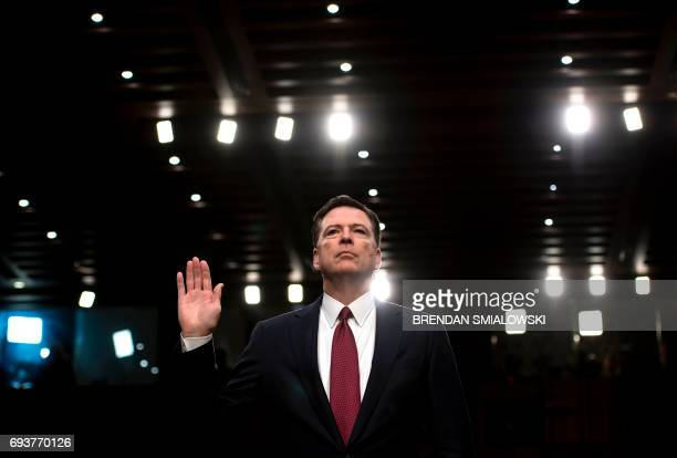 Ousted FBI director James Comey is sworn in during a hearing before the Senate Select Committee on Intelligence on Capitol Hill June 8 2017 in...