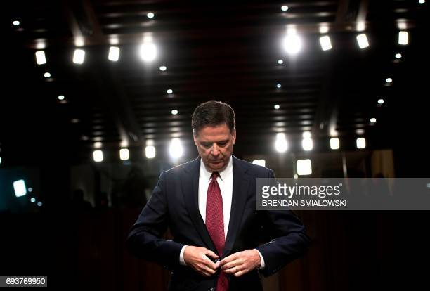 Ousted FBI director James Comey listens during a hearing before the Senate Select Committee on Intelligence on Capitol Hill June 8 2017 in Washington...