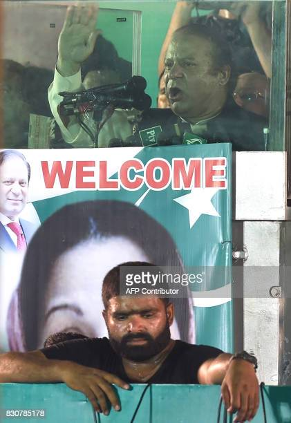 Ousted Pakistani Prime Minister Nawaz Sharif gestures as he addresses supporters at a rally after reaching his home city of Lahore on August 12 2017...