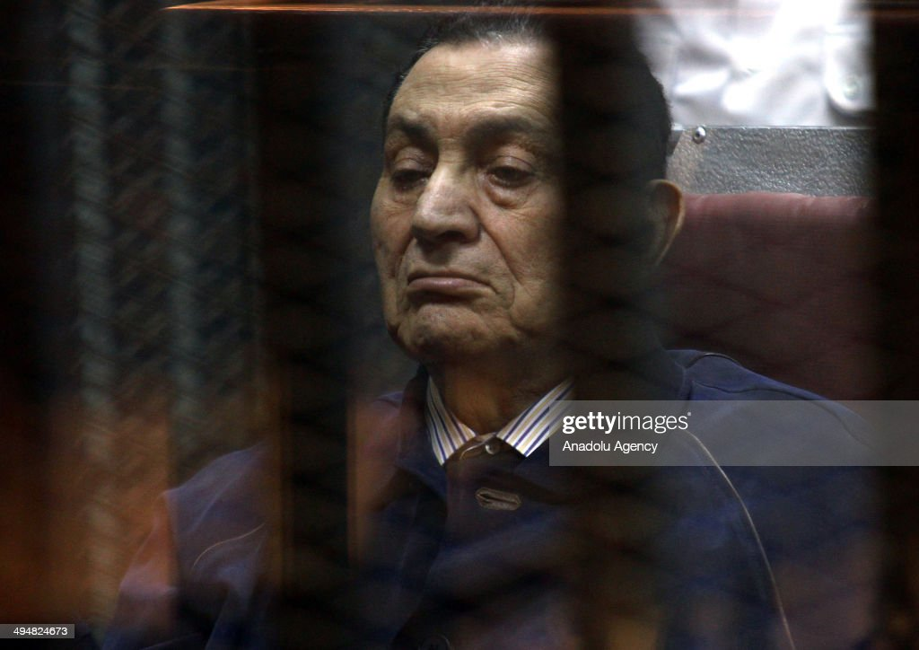 Ousted president of Egypt Hosni Mubarak (on the photo) stand trial with accusation of 'command of killing demonstrators' in Police Academy in Cairo, Egypt on 31 May, 2014. He is viewed with his blue convict clothes on the trial.