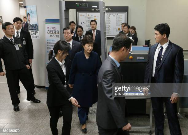 TOPSHOT Ousted South Korean President Park Geunhye leaves after a hearing at the Seoul Central District Court on March 30 2017 South Korea's ousted...